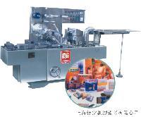 QD-99透明膜三维包装机/俗称烟包机/磁带包装机/化妆品包装机/**牌包装机